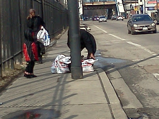 A couple struggles to get their groceries down the street to home