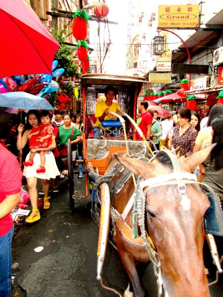 "CHINATOWN: A ""kalesa"" (horse carriage) gallops through a street in Binondo"