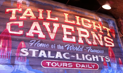 Tail Light Caverns Sign Racers Cars