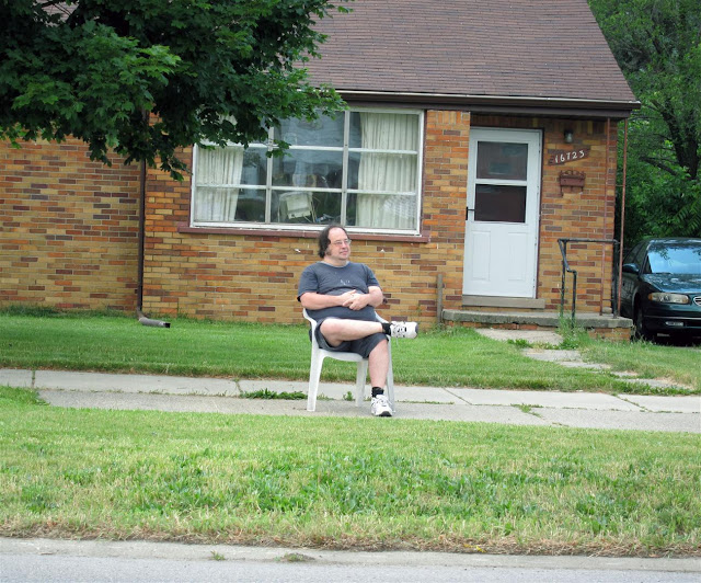 man sitting all alone