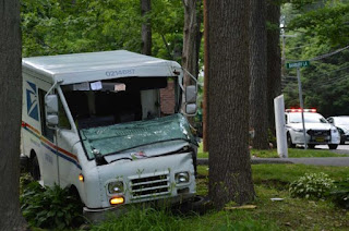 postal worker dies vehicle crash hit tree