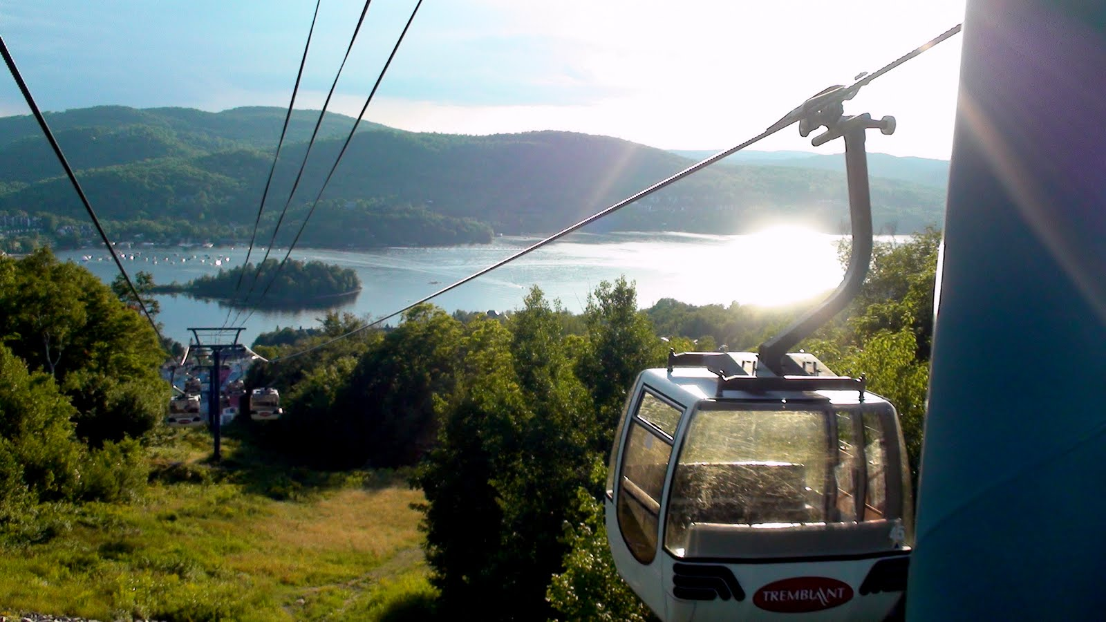 Taking the gondola up the mountain. Lac Tremblant below.