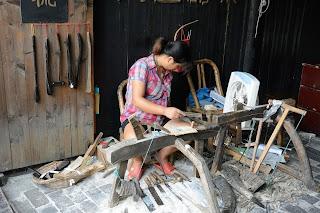 Artisan making horn combs in Wuzhen, Zhejiang, China