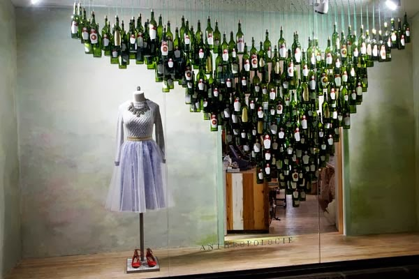 Check out these cool holiday windows the rocky mountain for Wine shop decoration