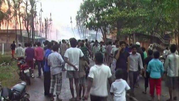 In this image taken from video, people gather on a street in Nagaram village, in the southern Indian state of Andhra Pradesh after a state-owned gas pipeline exploded Friday, June 27, 2014. A top official of the state-run Gas Authority of India Ltd, said more than a dozen people died in the fire following the explosion in the pipeline.
