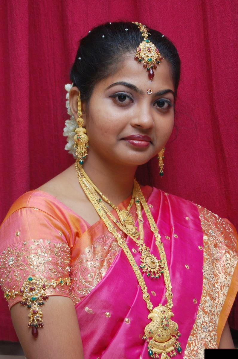 Newly Married bride posing for the camera with a cute smile.jpg