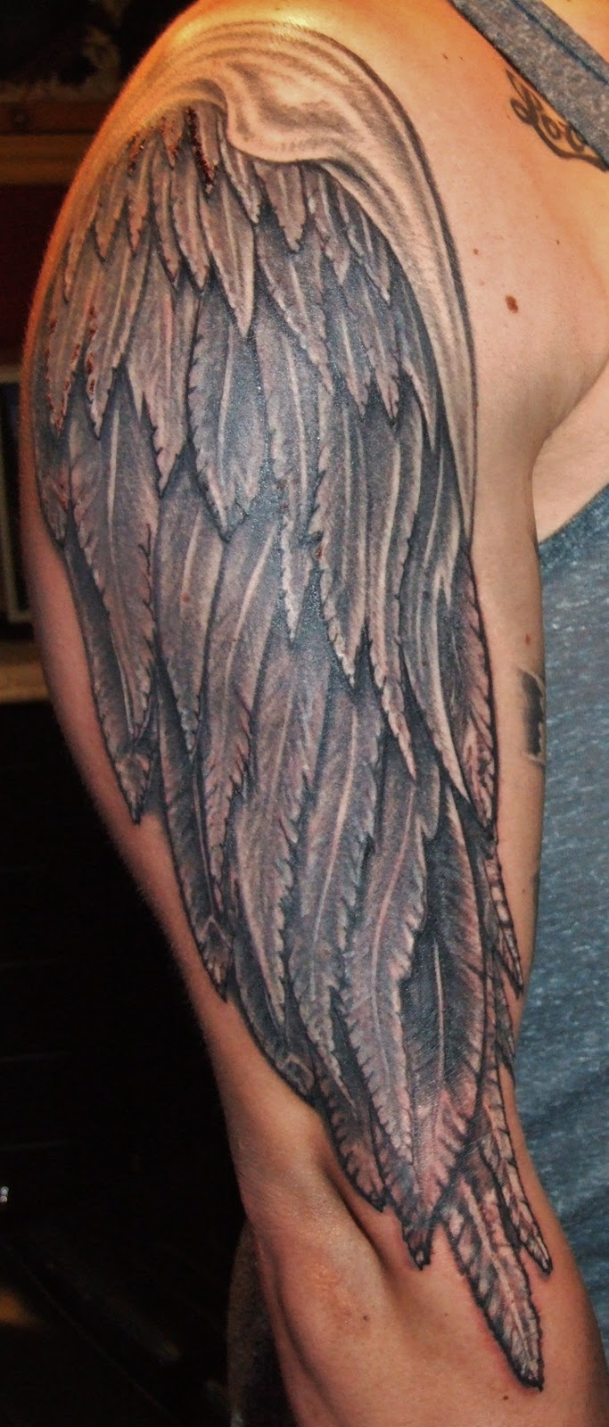 Exotic flesh tattoos arm wing for Wing tattoo arm