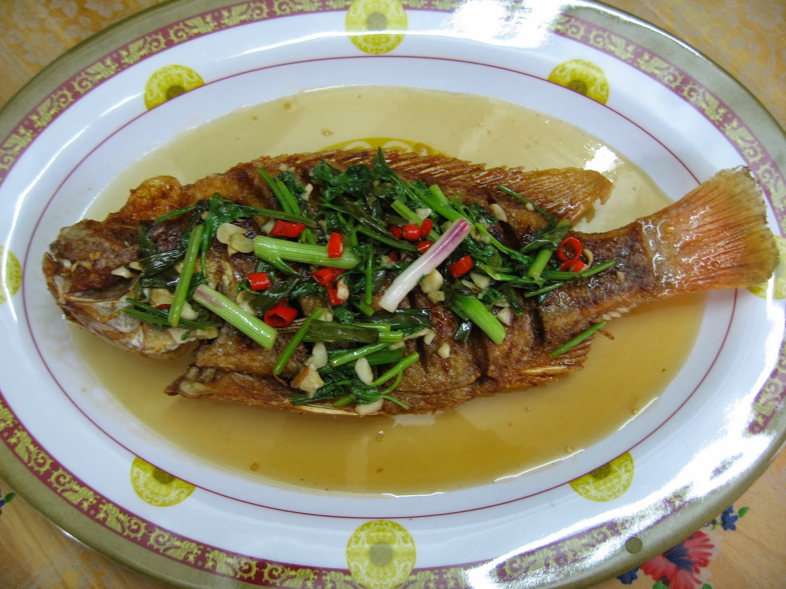 Sumptuous flavours deep fried fish with tangy sauce for Sauce for fried fish