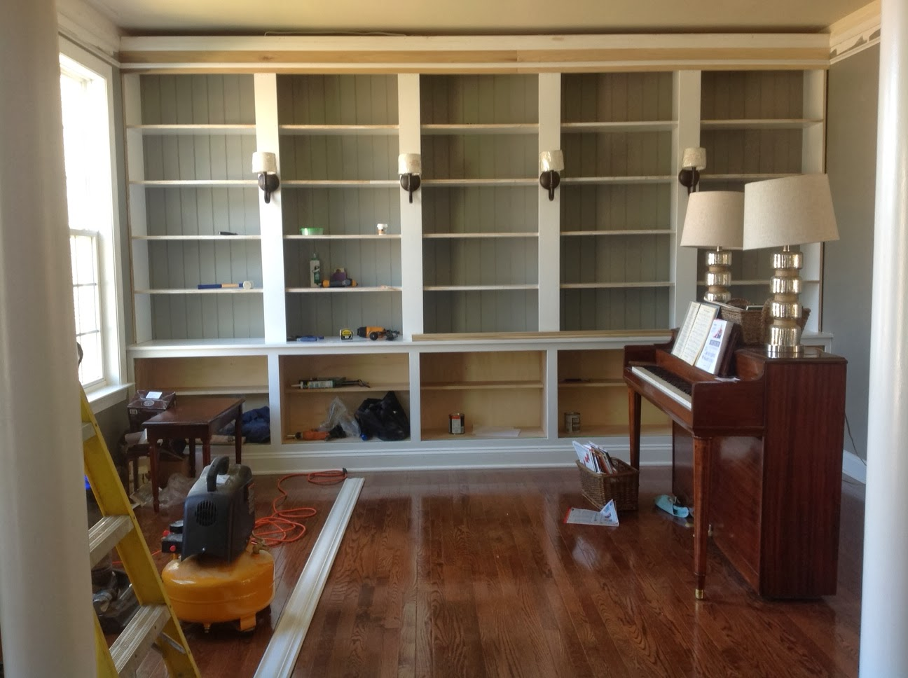 Amazing photo of Right up my alley: How We Built Our Library Bookshelves with #906C3B color and 1296x968 pixels