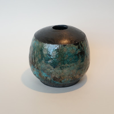 Beautiful raku glazed pottery by Lily.