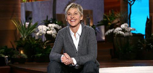 Ellen Degeneres smiling with plants in background