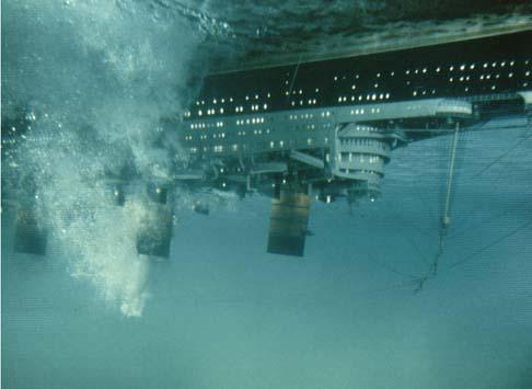 Ship underwater, lights blazing, explosions in The Poseidon Adventure