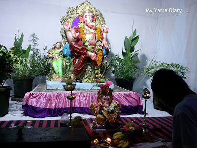 Ganesh Pandal decorated with flowers and plants in Mumbai