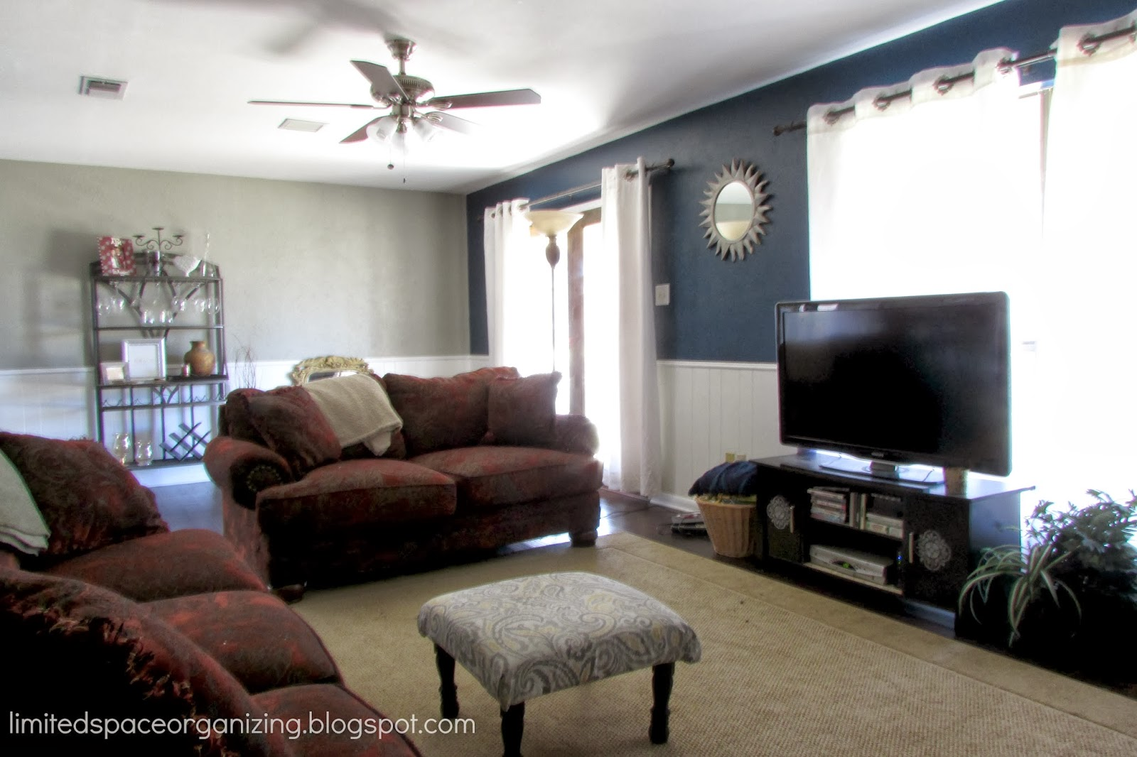 Living room paint ideas accent wall - Limited Space Organizing Living Room Update Navy Blue Accent Wall