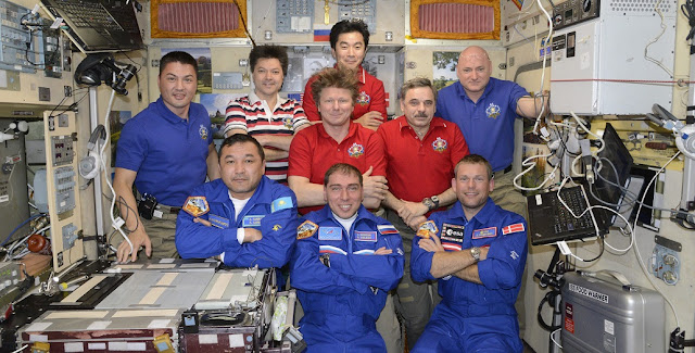 An international crew of nine from the U.S.. Russia, Japan, Denmark and Kazakhstan will work together on the orbital laboratory until Sept. 11. Credit: NASA