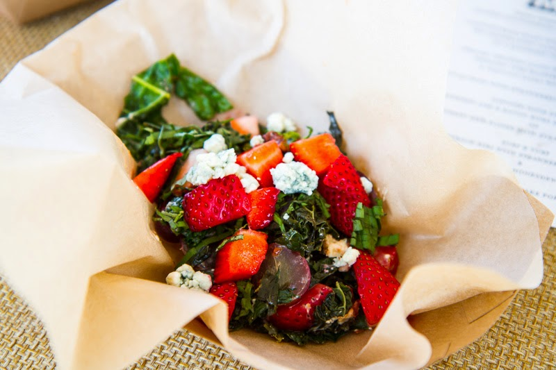 Kale and Strawberry Salad with Grapes, Candied Pecans, Blue Cheese and a Raspberry Vinaigrette
