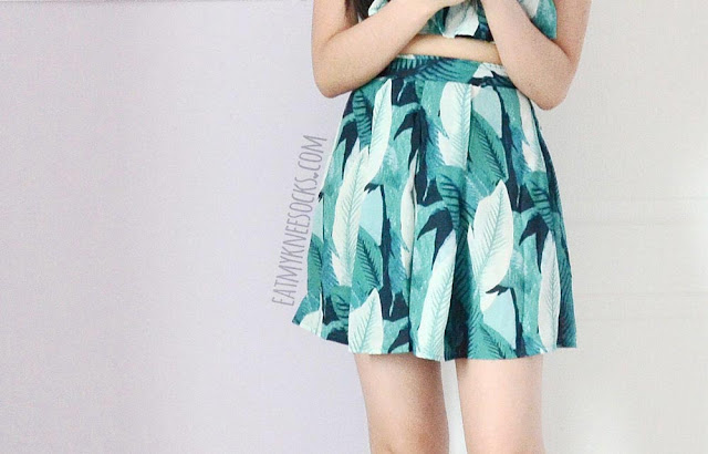 WalkTrendy's leaf-print two-piece set comes with flowy high-waisted patterened shorts that look like a skort or skirt.