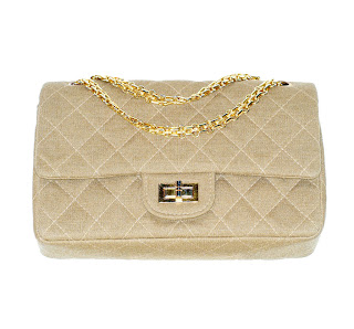 Vintage 1960's tan colored Chanel bag with gold mademoiselle closure and chain strap.