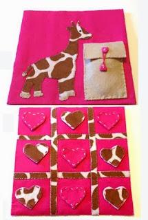 http://brochesdefieltro.net/2014/01/tres-en-raya-con-jirafa-en-fieltro-con-plantilla-para-descargar-gratis/