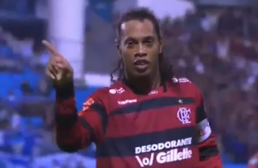 Ronaldinho celebrates after scoring straight from the corner against Avaí