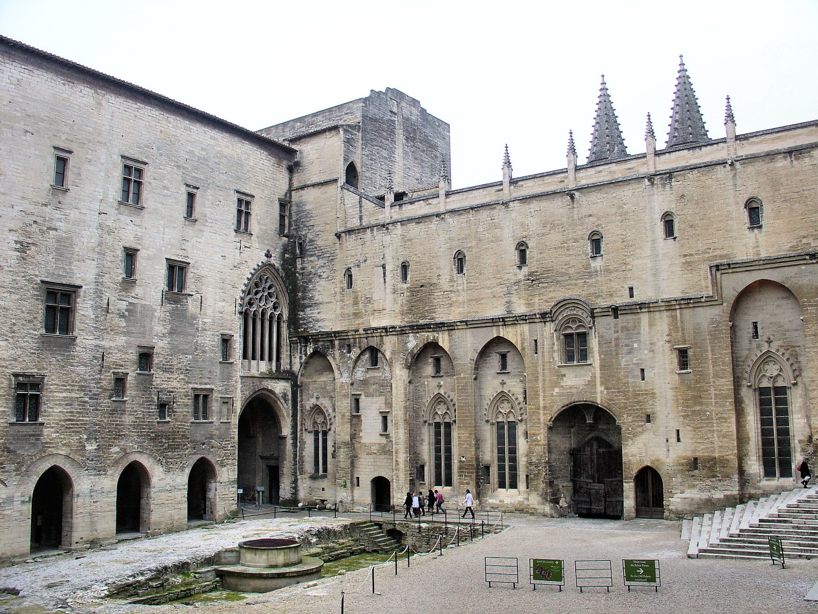 Central Courtyard. The fountain at the left was formerly the site of Pope John XXII's Audience Chamber.