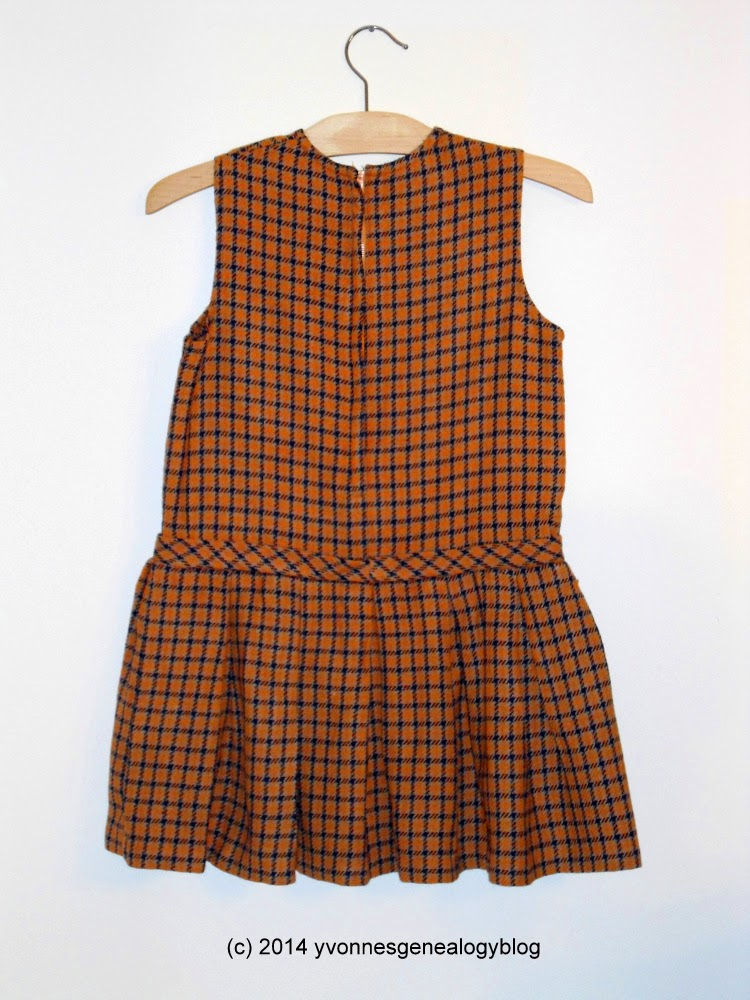 Back view of child's wool plaid-patterned dress