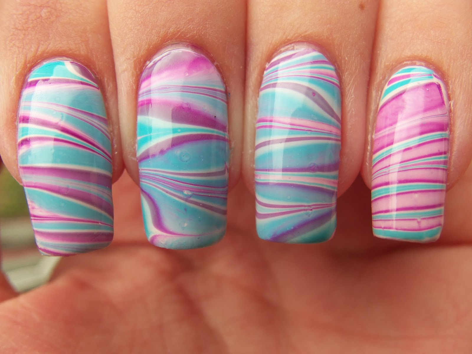 http://megsmanicures.blogspot.com/2014/09/pinks-and-blues-water-marble.html