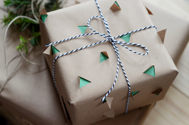 double wrapped gift wrap using coloured tissue paper and brown paper with shapes cut out