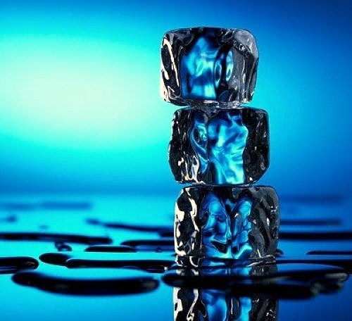 Melting Ice Cubes Standing Together