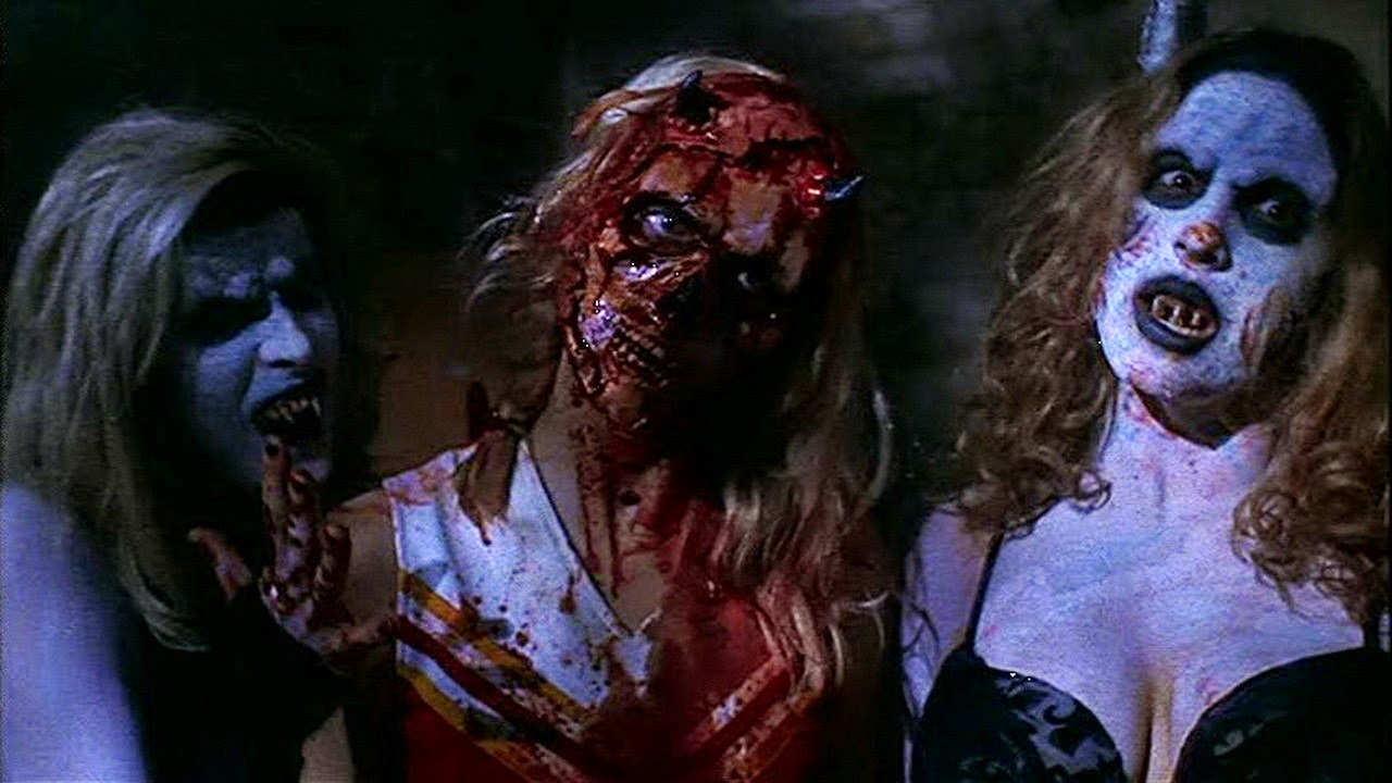 A cheerleader with a peeled face accompanied by two former weekend Satanists in The Convent (2000)