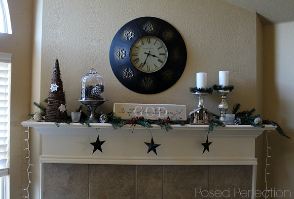 A Tranquil Christmas Mantel with pine bows and pine cones keeps