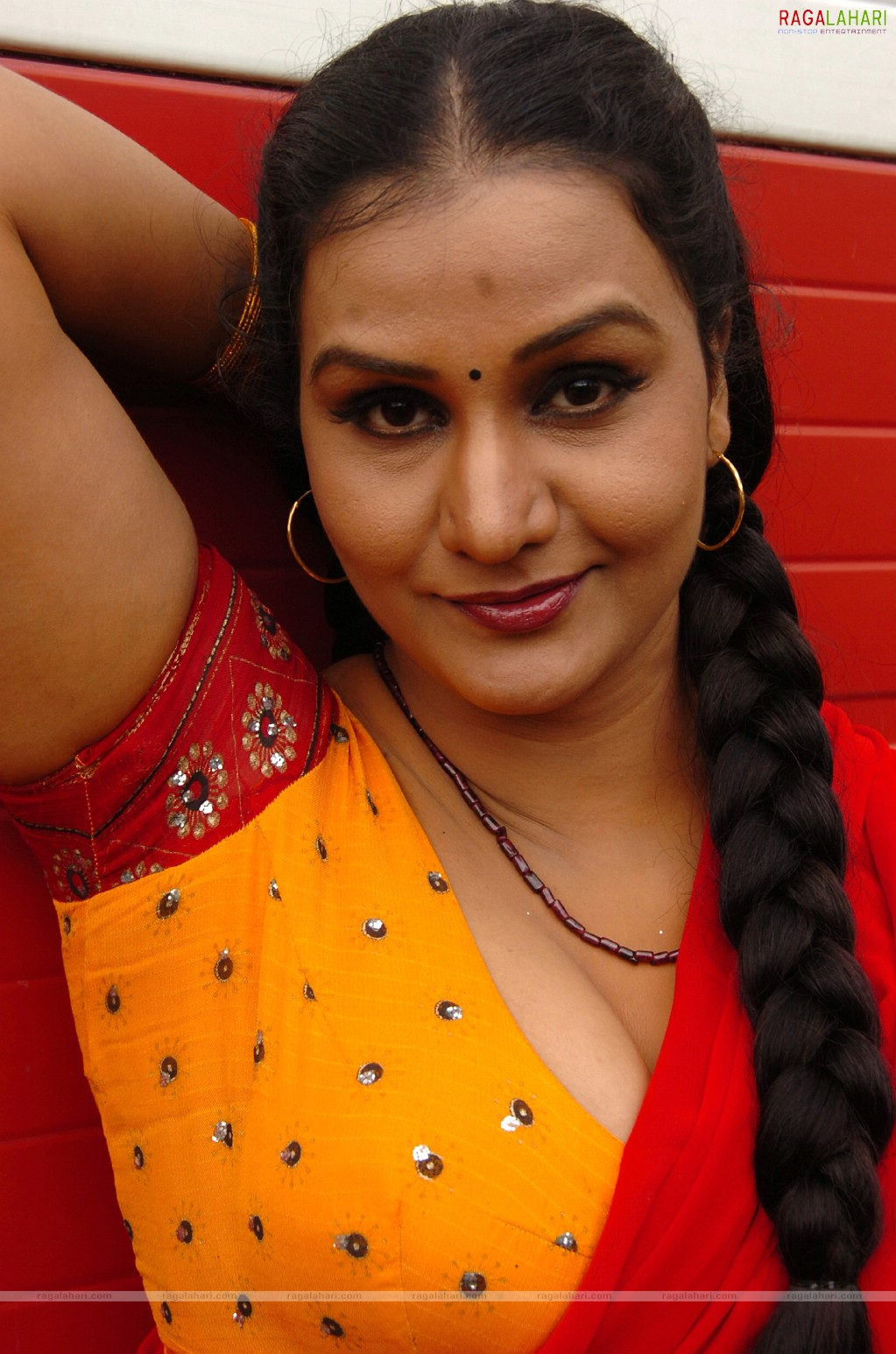 Apoorva Aunty Telugu Movie Photoshoot In Red Half Saree  Out