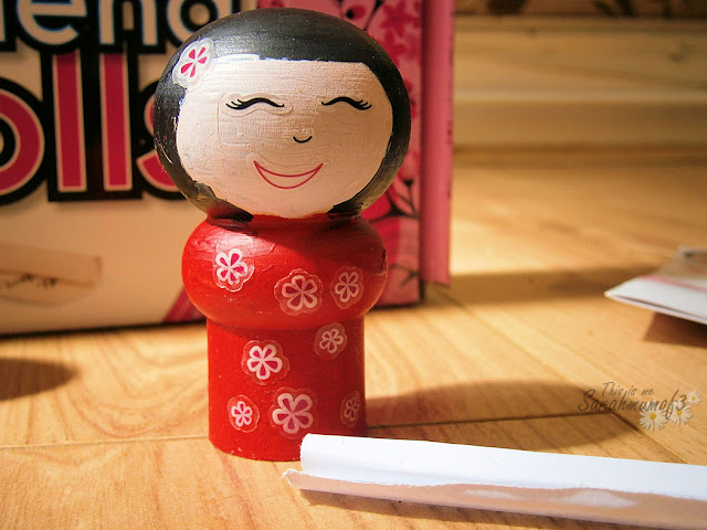 wooden japanese doll painted