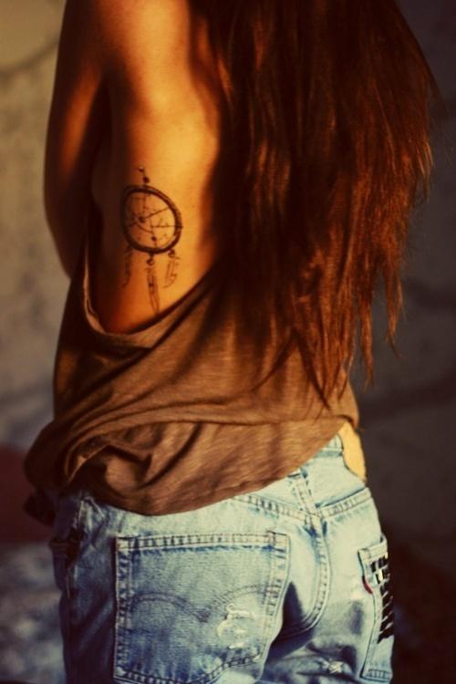 Dream catcher tattoo on side body