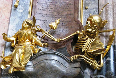 Gilded sculptures of skeleton cutting thread of life for unfortunate mortal