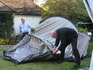 Mr A and J lifting the tent into shape