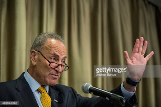 Senator Chuck Schumer (D-N.Y.) at a press conference for a new Hudson River rail tunne