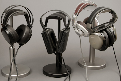 three aluminum headphone stands, in black and silver finishes