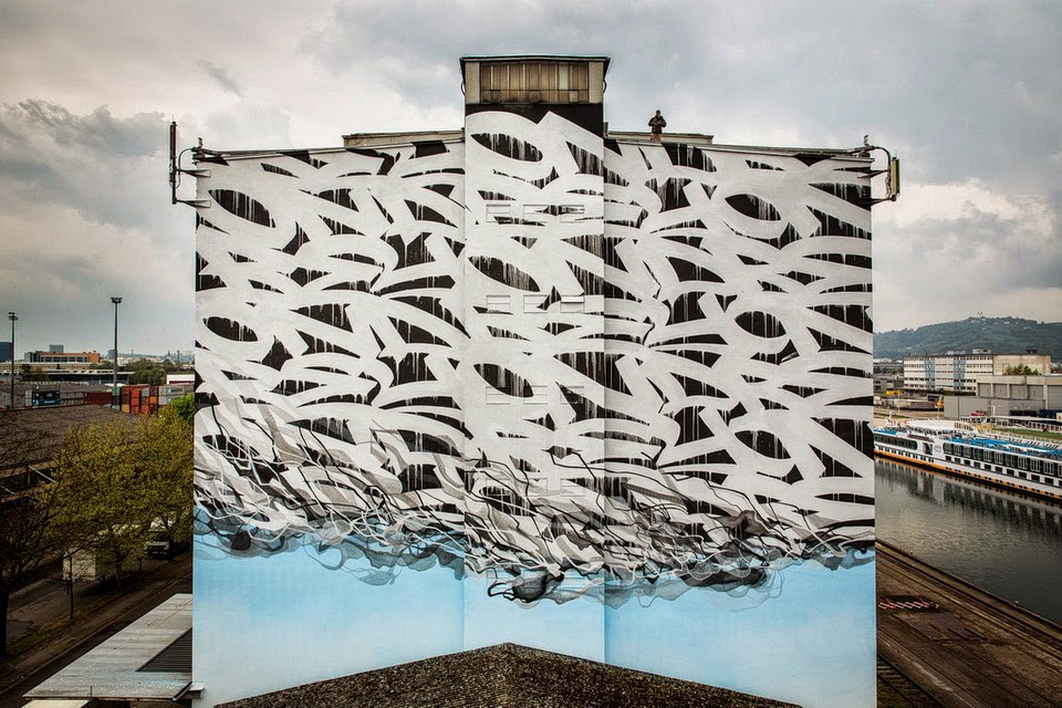 After an entire week of work, German artist Stohead finished his latest huge mural on the streets of Linz, Austria.