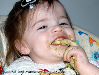 toddler eating avocados