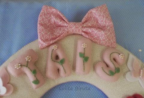 Laço de tecido estampado para decorar guirlandas
