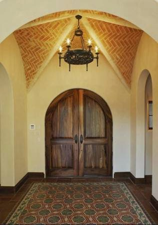 Saltillo tile entry with cement tile rug