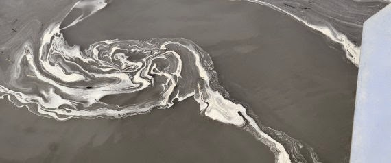 A vortex of coal ash swirls in the gray waters of the Dan River at Danville, Va. downstream from the Duke Energy Steam Station in Eden, N.C. The EPA issued new rules for the disposal of coal ash on Friday. (Credit: John D. Simmons/Charlotte Observer/MCT via Getty Images) | Charlotte Observer via Getty Images) Click to Enlarge.
