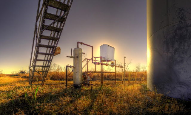 Sunset behind the tanks of a pumping station in George Bush Park - Houston, Texas - HDR - Panoramic