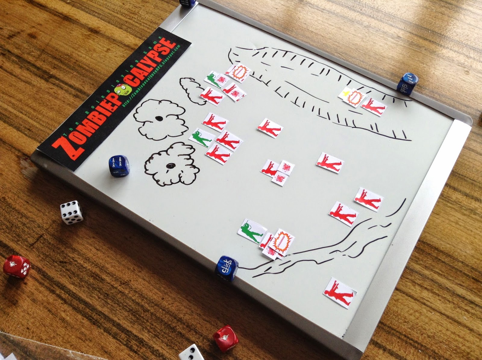 Paper tokens played on a whiteboard map