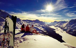 Snowboarders Wathing Sun on Top of Mountain HD Wallpaper