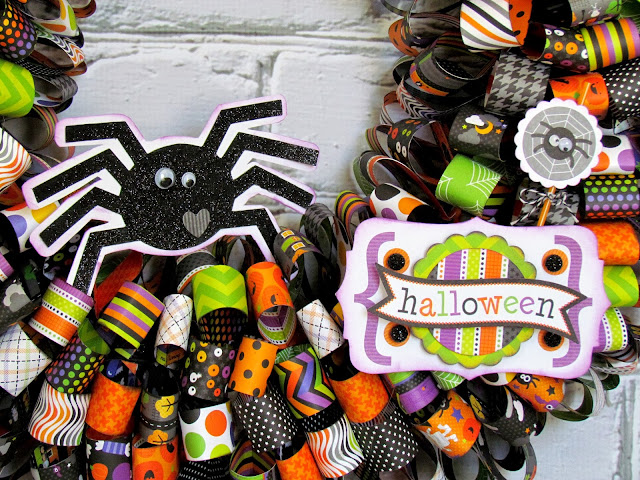 add spiders to a Halloween wreath