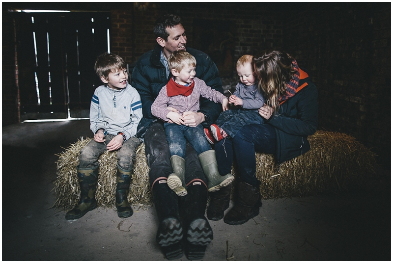 A family portrait in a barn