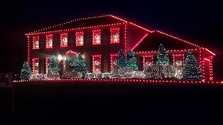 red green and white lights outlining a house at night