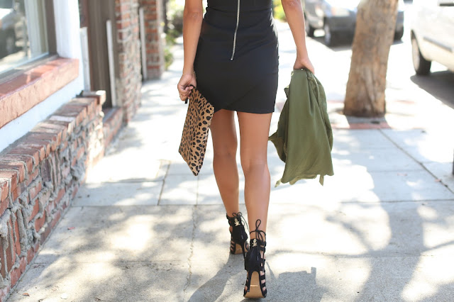 leopard clutch and black dress, holiday styling